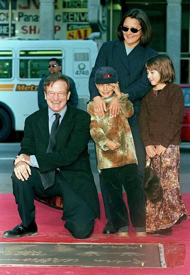 This file photo taken on December 22, 1998 shows US Academy Award-winning actor Robin Williams (left) posing with family members Cody (center), Zelda (right) and wife Marsha (back right) during Williams' hand and footprint ceremony outside the Mann's Chinese Theatre in Hollywood, California.  Oscar-winning actor and comedian Robin Williams died on August 11, 2014 after battling depression, triggering an outpouring of tributes to one of the most beloved entertainers of his generation.  Photo: Vince Bucci, AFP/Getty Images