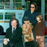 (FILES) This file photo taken on December 22, 1998 shows US Academy Award-winning actor Robin Williams (L) posing with family members Cody (C), Zelda (R) and wife Marsha (back R) during Williams' hand and footprint ceremony outside the Mann's Chinese Theatre in Hollywood, California.  Oscar-winning actor and comedian Robin Williams died from suspected suicide on August 11, 2014 after battling depression, triggering an outpouring of tributes to one of the most beloved entertainers of his generation.      AFP PHOTO / FILES / Vince BUCCIVINCE BUCCI/AFP/Getty Images