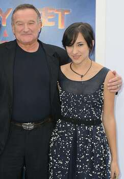 "FILE - This Nov. 13, 2011 file photo shows actor Robin Williams, left, and his daughter, Zelda at the premiere of  ""Happy Feet Two"" in Los Angeles. Williams, whose free-form comedy and adept impressions dazzled audiences for decades, has died in an apparent suicide. He was 63. The Marin County Sheriff's Office said Williams was pronounced dead at his home in California on Monday, Aug. 11, 2014. The sheriff's office said a preliminary investigation showed the cause of death to be a suicide due to asphyxia. (AP Photo/Katy Winn, File) Photo: Katy Winn, Associated Press"
