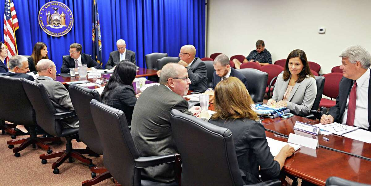 JCOPE members convene for a state ethics commission meeting Tuesday, Aug. 12, 2014, in Albany, N.Y. (John Carl D'Annibale / Times Union)