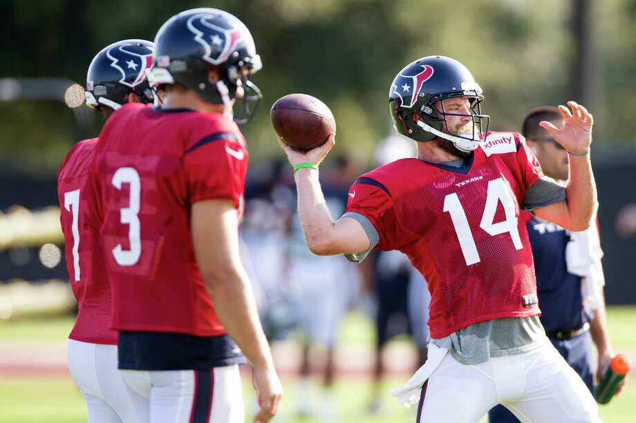 Houston Texans quarterback Ryan Fitzpatrick throws a pass during Texans training camp at the Methodist Training Center Tuesday, Aug. 12, 2014, in Houston.  ( Brett Coomer / Houston Chronicle ) Photo: Brett Coomer, Staff / © 2014 Houston Chronicle
