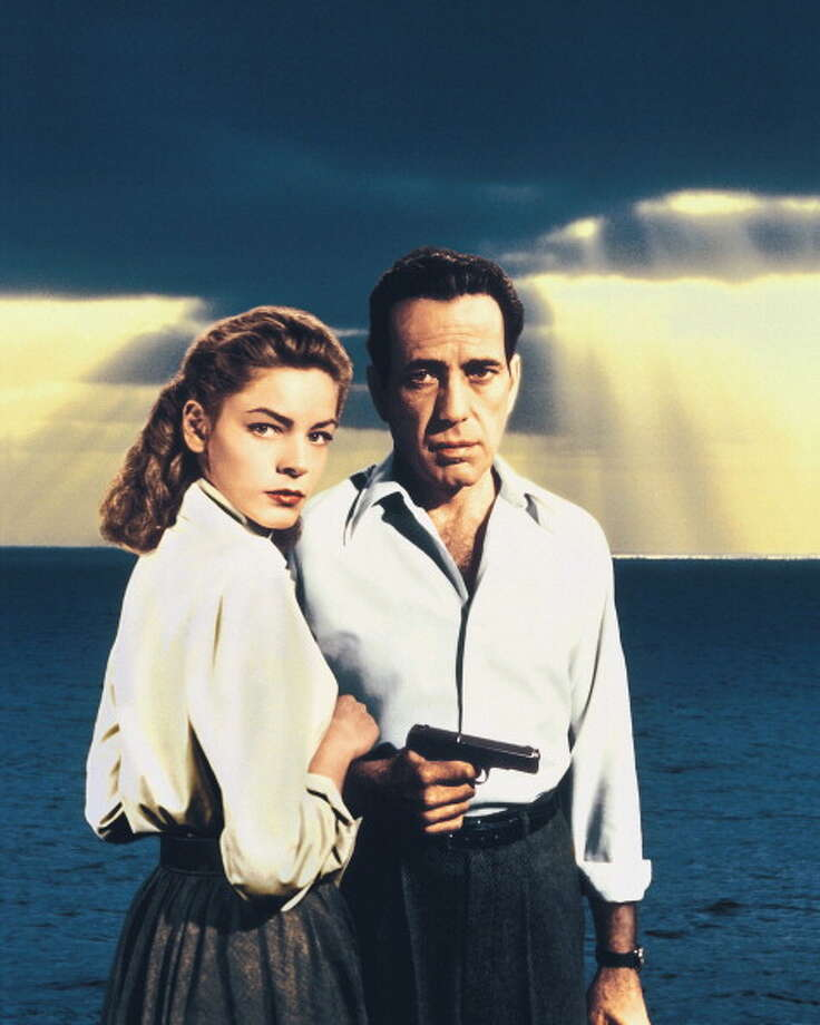 Lauren Bacall, US actress, and Humphrey Bogart (1899-1957), US actor, holding a handgun in a publicity portrait issued for the film, 'Key Largo', with the sea in the background, USA, 1948. The film, directed by John Huston (1906-1987), starred Bacall as 'Nora Temple', and Bogart as 'Frank McCloud'. (Photo by Silver Screen Collection/Getty Images) Photo: Silver Screen Collection, Getty Images / 2011 Silver Screen Collection