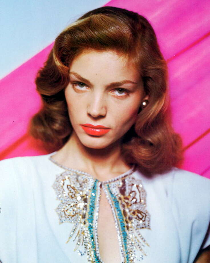 Lauren Bacall, US actress, wearing a white top with a keyhole necklace with sequinned decoration in a studio portrait, against a pink background, circa 1945. (Photo by Silver Screen Collection/Getty Images) Photo: Silver Screen Collection, Getty Images / 2011 Silver Screen Collection