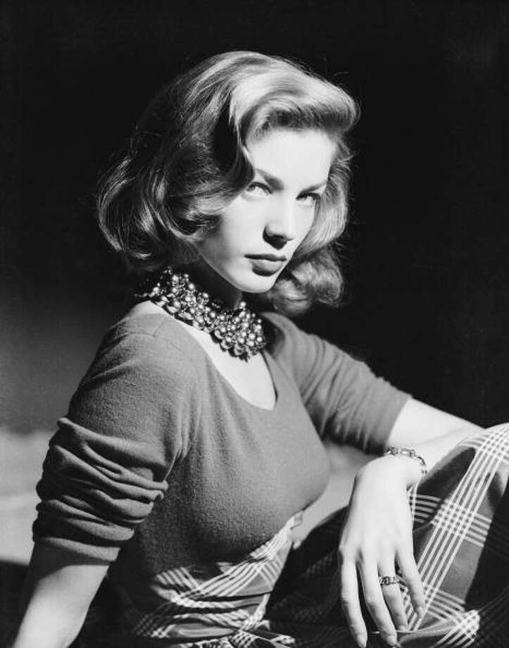 circa 1945:  American screen star Lauren Bacall wearing an ornate beaded necklace.  (Photo via John Kobal Foundation/Getty Images) Photo: John Kobal Foundation, Getty Images / Moviepix