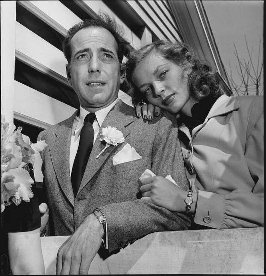 MANSFIELD, UNITED STATES - MAY 21:  Newlywed actors Humphrey Bogart and Lauren Bacall attending wedding reception at home of novelist Louis Bromfeld.  (Photo by Ed Clark/The LIFE Picture Collection/Getty Images) Photo: Ed Clark, The LIFE Picture Collection/Gett / Time & Life Pictures/Getty Images