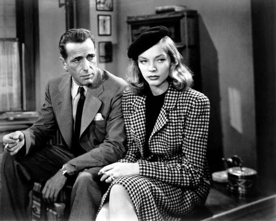 Humphrey Bogart (1889 - 1957) as Philip Marlowe and Lauren Bacall as Vivian Rutledge in 'The Big Sleep', 1946. (Photo by Silver Screen Collection/Getty Images) Photo: Silver Screen Collection, Getty Images / 2010 Getty Images