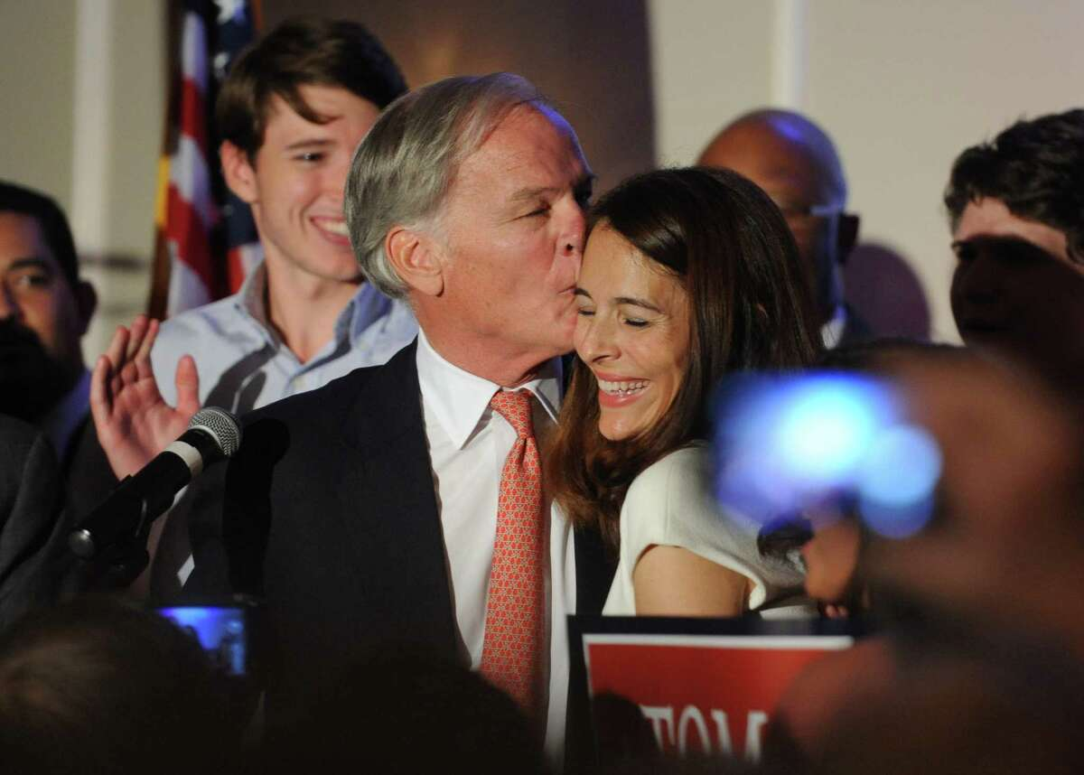 Tom Foley, of Greenwich, kisses his wife Leslie after hearing the results of the 2014 Republican gubernatorial primary election at the Pontelandolfo Community Club in Waterbury, Conn. Tuesday, Aug. 12, 2014. Foley, former U.S. Ambassador to Ireland, defeated John McKinney and will run against incumbent Democratic Gov. Dannel P. Malloy in the 2014 Connecticut gubernatorial election on Nov. 4, 2014.