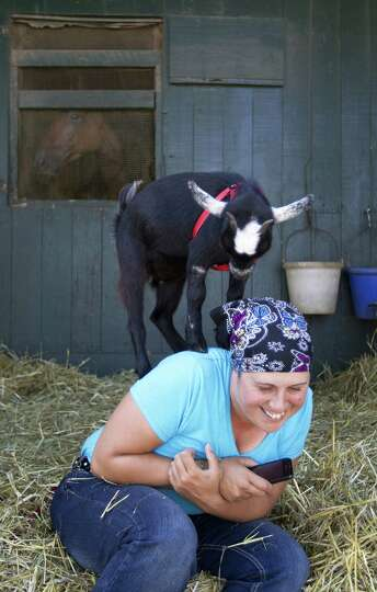 Lilly, 5-month-old pygmy goat, at Saratoga Race Course.  With owner Natalie Rutigliano.
