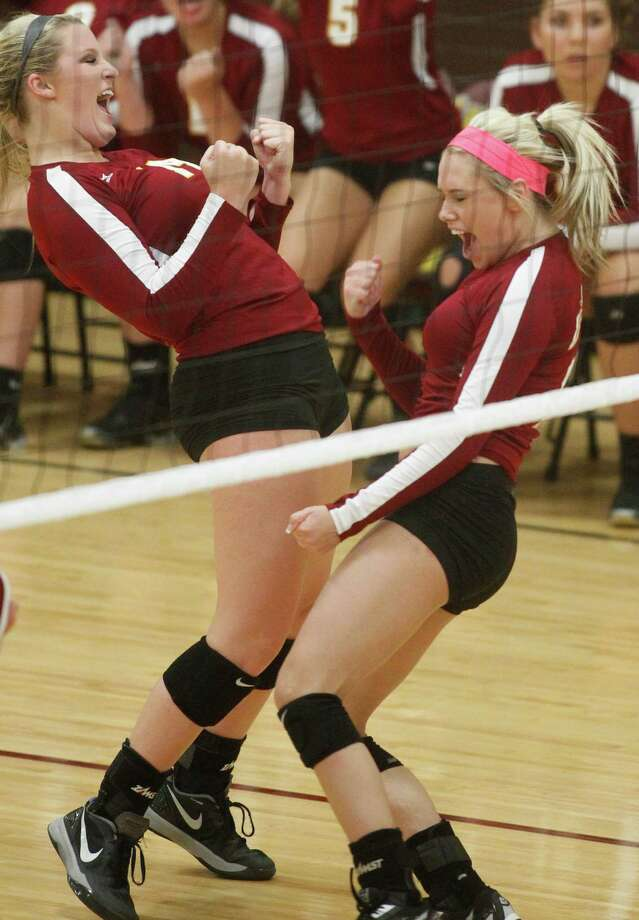 Deer Park's Maddie Wallace, left, and Raejan Hays celebrate a point  during a high school volleyball game against Clear Falls on Tuesday, Aug. 12, 2014, in Deer Park. Photo: J. Patric Schneider, For The Chronicle / © 2014 Houston Chronicle
