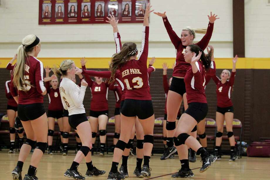Deer Park celebrates a point during a high school volleyball game against Clear Falls on Tuesday, Aug. 12, 2014, in Deer Park. Photo: J. Patric Schneider, For The Chronicle / © 2014 Houston Chronicle