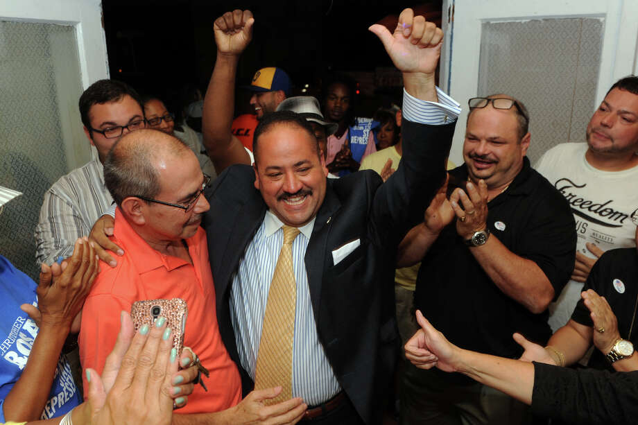 State Sen. Andres Ayala is greeted by supporters in Bridgeport after winning Tuesday's Democratic primary in the 23rd District, Aug. 12, 2014. Photo: Ned Gerard / Connecticut Post