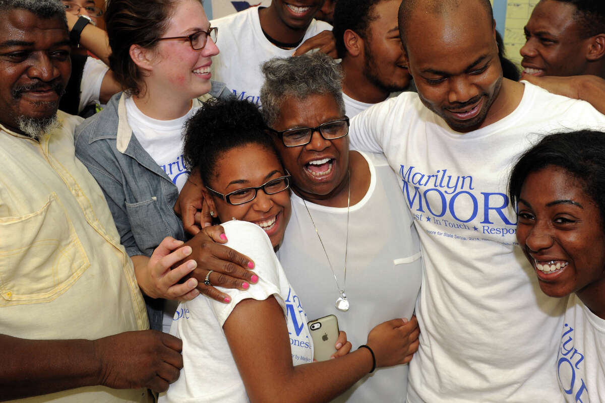 Marilyn Moore is congratulated by Iman Doss and other supporters in Bridgeport after her victory over incumbent state Sen. Anthony Musto in Tuesday's Democratic primary in the 22nd District, Aug. 12, 2014.
