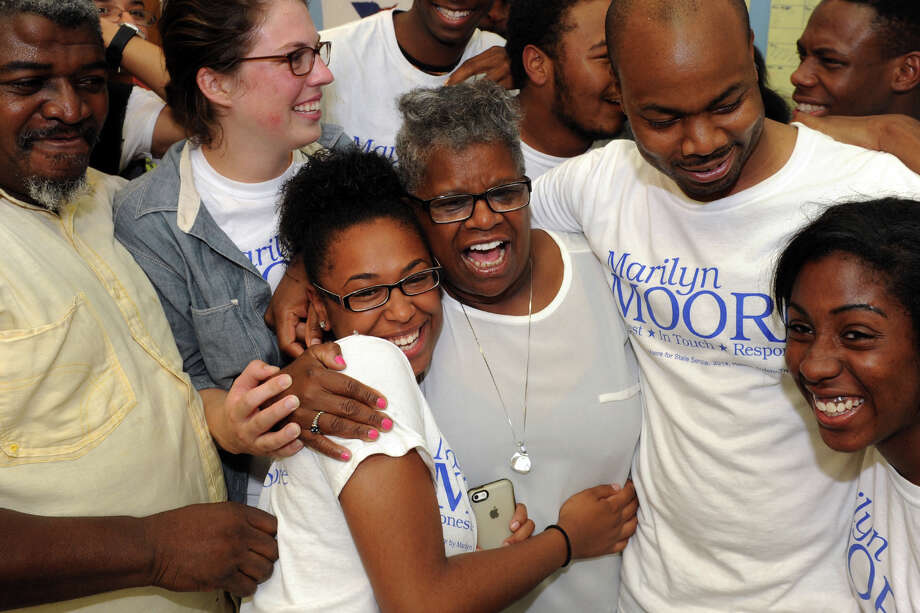 Marilyn Moore is congratulated by Iman Doss and other supporters in Bridgeport after her victory over incumbent state Sen. Anthony Musto in Tuesday's Democratic primary in the 22nd District, Aug. 12, 2014. Photo: Ned Gerard / Connecticut Post