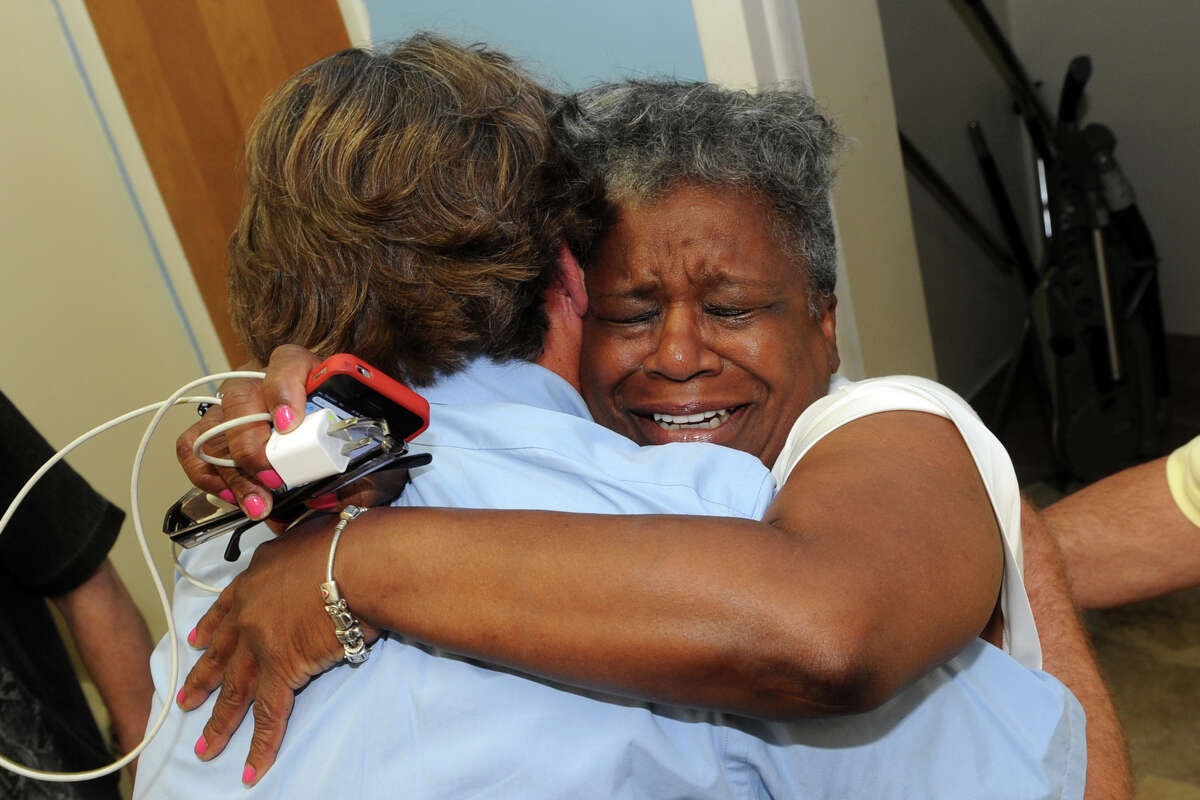 Marilyn Moore hugs a supporter in Bridgeport after her victory over incumbent state Sen. Anthony Musto in Tuesday's Democratic primary in the 22nd District, Aug. 12, 2014.