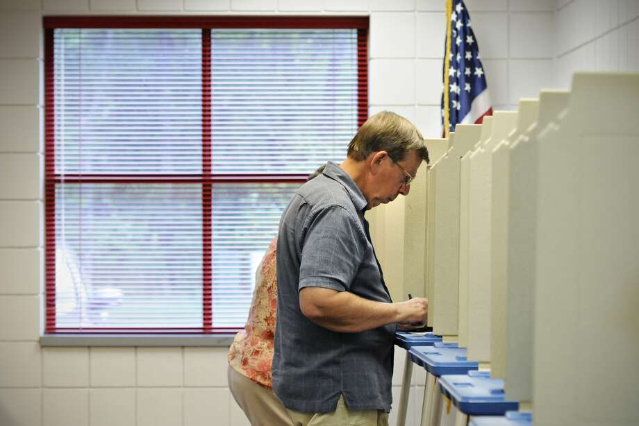 Ron Stewart complete his ballot during the primary election at the St. Joseph Community Fire Station Tuesday, Aug. 12, 2014, St. Joseph, Minn.  (AP Photo/St. Cloud Times, Jason Wachter) NO SALES Photo: JASON WACHTER, MBR / ST. CLOUD TIMES