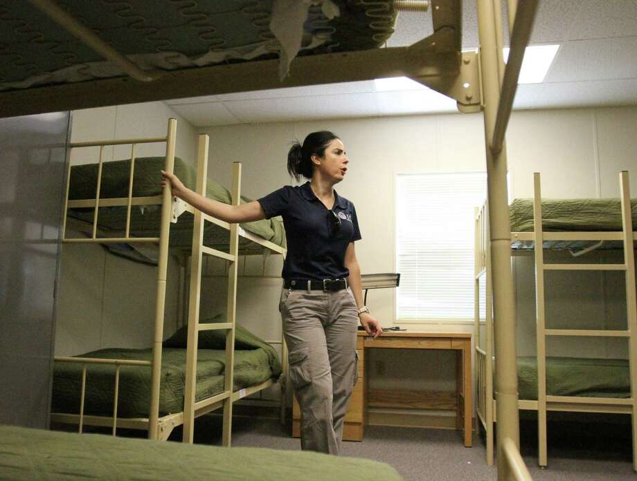 Barbara Gonzalez, public information officer for Immigration and Customs Enforcement, shows a dormitory where migrant families are housed at the Artesia Residential Detention Facility. Photo: Rudy Gutierrez / Associated Press / POOL The El Paso Times