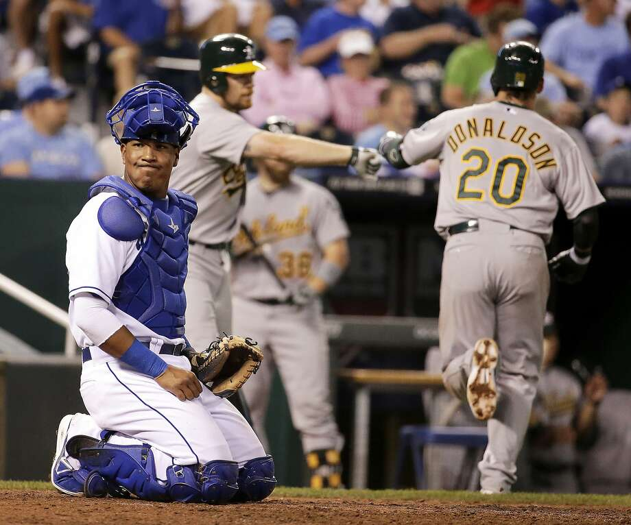Royals catcher Salvador Perez isn't watching as Josh Donaldson is greeted after the first of his two solo home runs. Photo: Charlie Riedel, Associated Press
