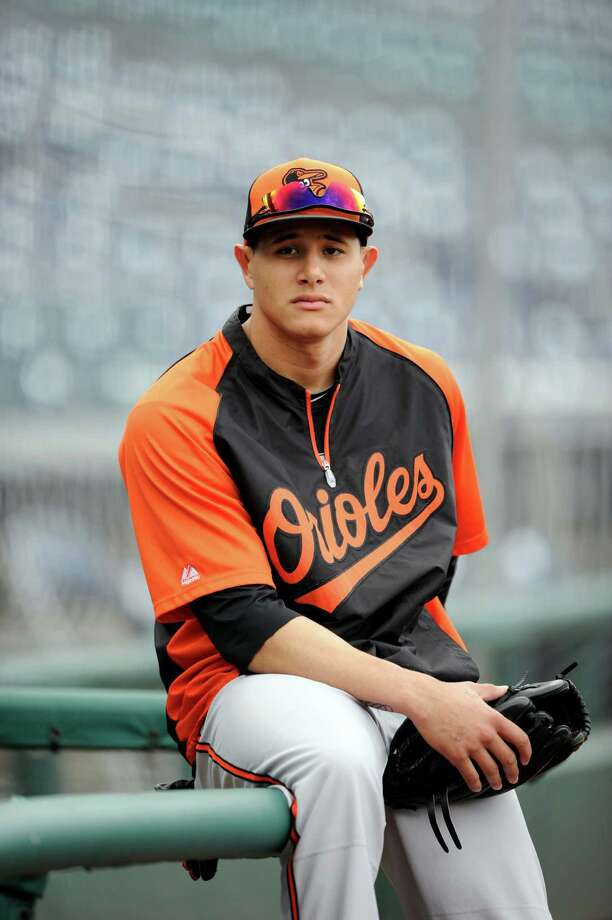 Baltimore Orioles' Manny Machado looks on before a baseball game against the Washington Nationals, Monday, Aug. 4, 2014, in Washington. (AP Photo/Nick Wass) Photo: Nick Wass, FRE / FR67404 AP