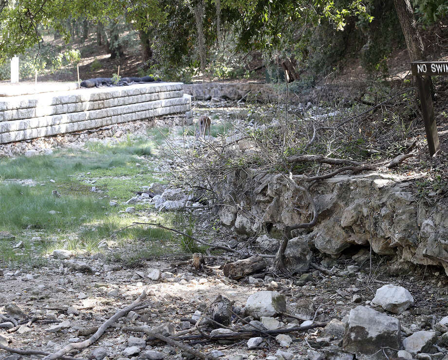 A portion of Comal Springs remains drought-stricken. Parts of Comal County must adhere to Edwards Aquifer pumping cuts. Photo: Photos By Tom Reel / San Antonio Express-News