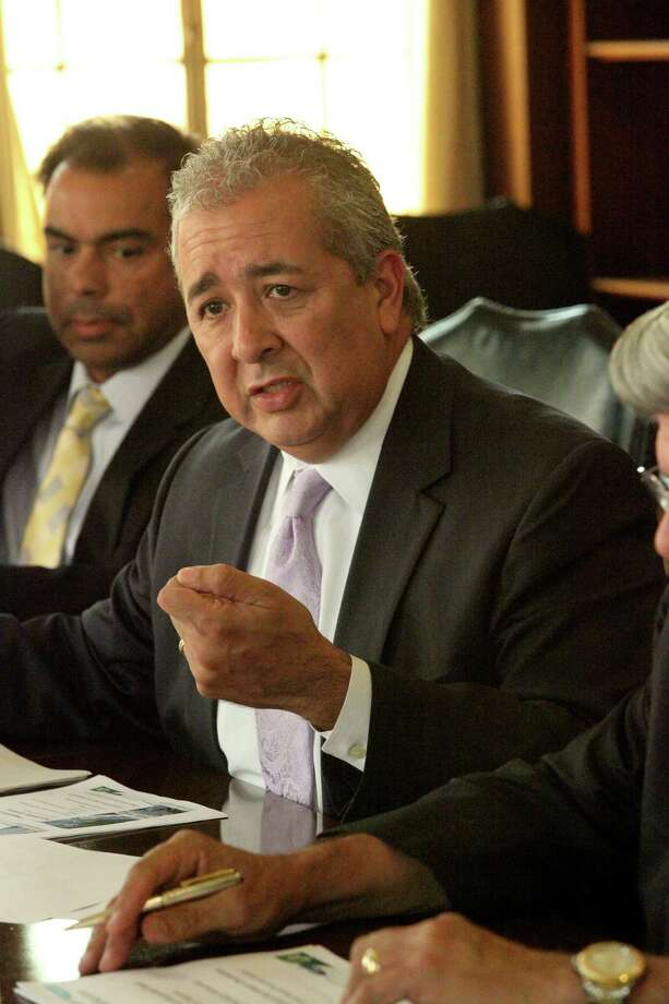 Robert R. Puente, president and CEO of SAWS talks to Saen board about water pipeline project, Wednesday July 30, 2014 Photo: San Antonio Express-News / San Antonio Express-News