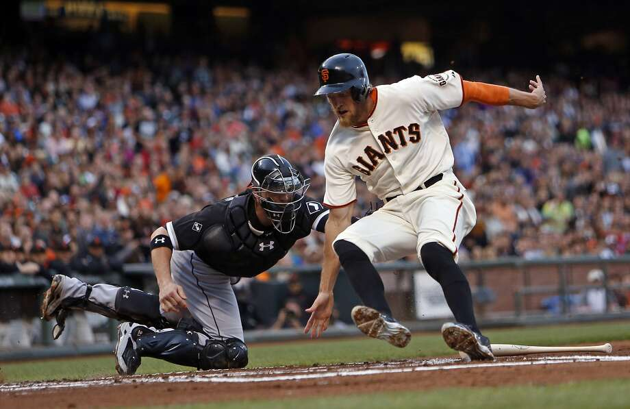 Hunter Pence is tagged out at home by Tyler Flowers in the first inning. Photo: Scott Strazzante, The Chronicle