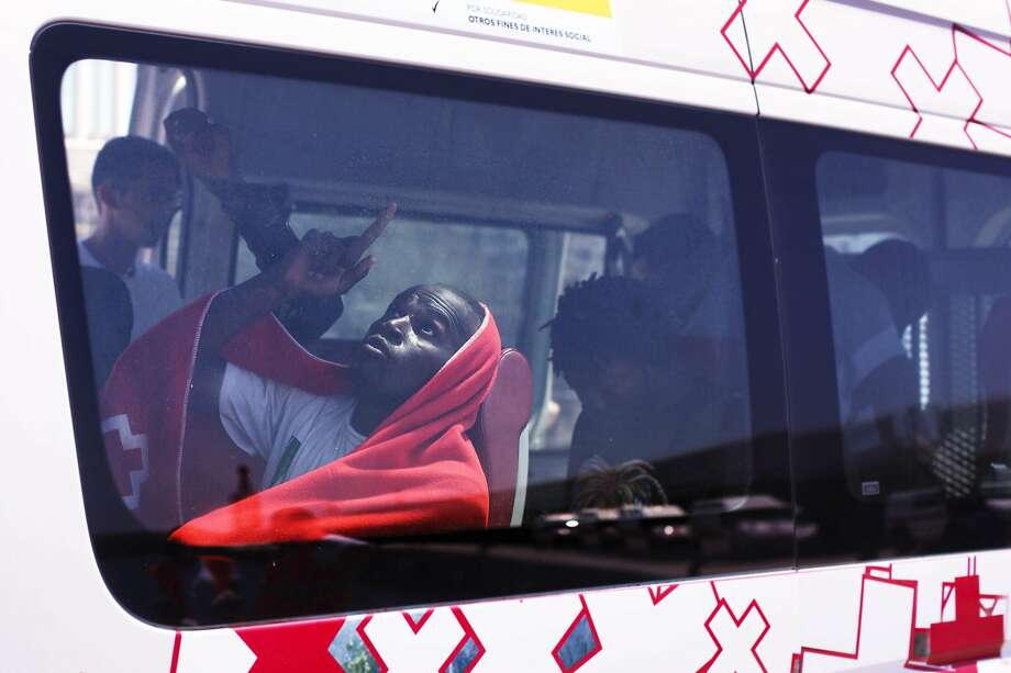 TARIFA, SPAIN - AUGUST 12:  African migrant gestures inside a Red Cross vehicle after being rescued by a Spanish coast guard vessel in the port of Tarifa on August 12, 2014 in Tarifa, Spain. Spain's coast guard said it picked up 710 sub-Saharan Africans who were crossing the Strait of Gibraltar in 12 small boats, part of a surge of migrants across the Mediterranean to Europe's southern shores.  (Photo by Sergio Camacho/Getty Images) *** BESTPIX *** Photo: Sergio Camacho, Getty Images