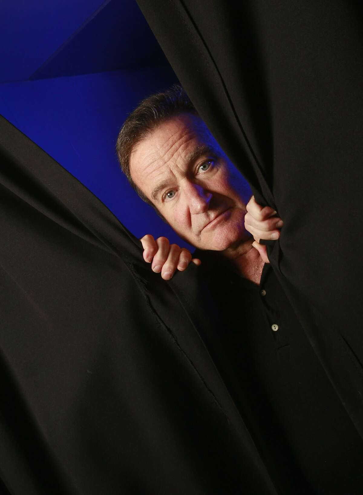 FILE -- Robin Williams, during a tour of 30 cities, backstage before his performance at the Ted Constant Convocation Center in Norfolk, Va., Oct. 26, 2009. Williams, an Oscar-winning actor and comedian, was found unconscious at home around noon on Aug. 11, 2014, a Marin County Sheriff's Office statement said. His death appeared to be a suicide due to asphyxia, the statement said. He was 63. (Jay Paul/The New York Times)