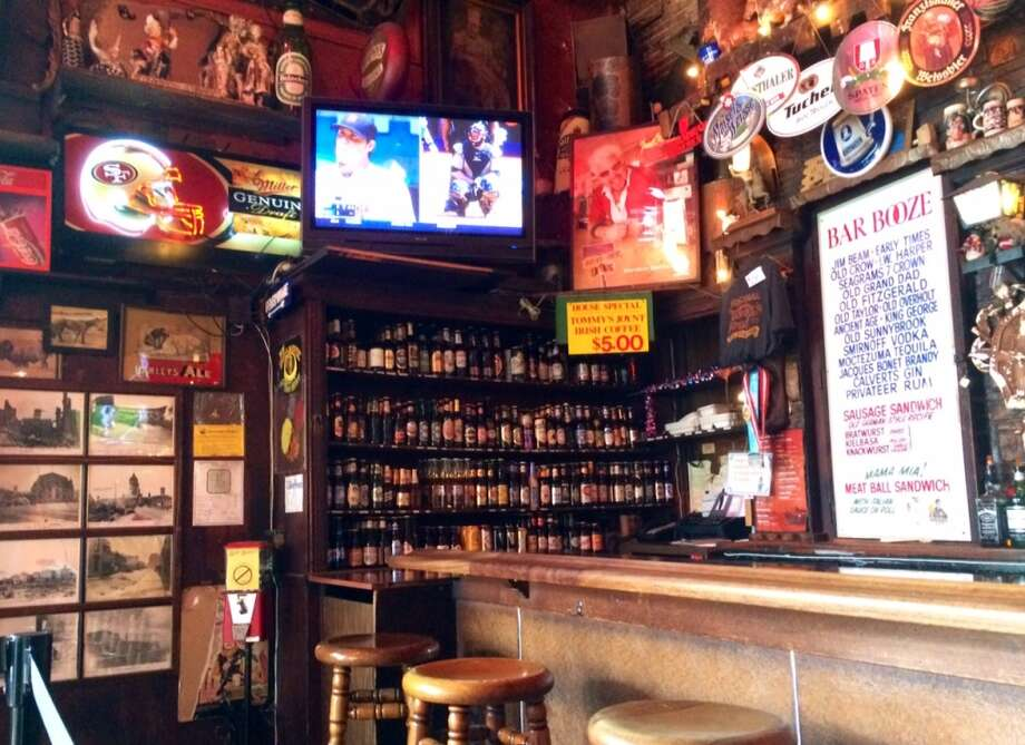 Tommy's has more than 100 beers, displayed on shelves beside the bar.