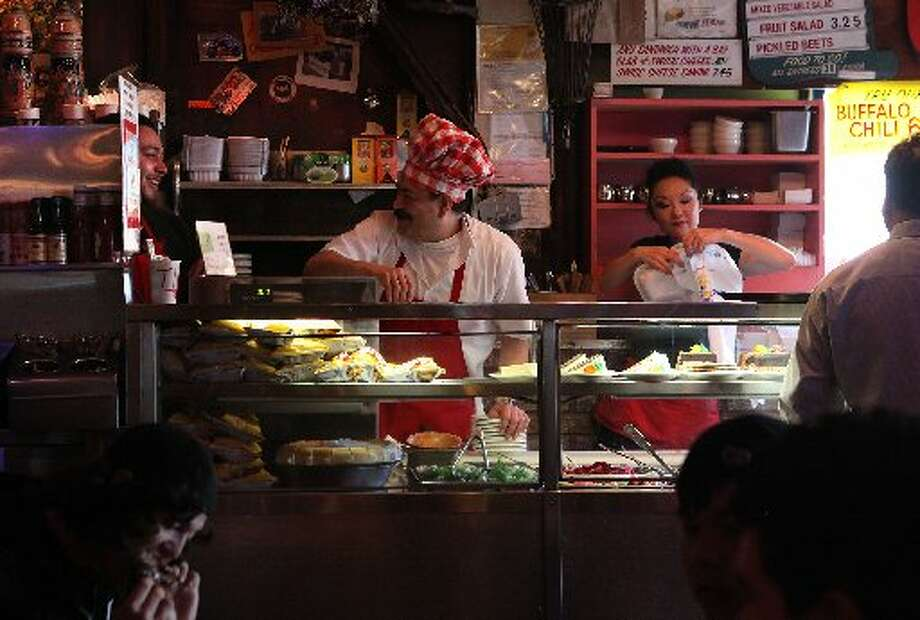 The chefs always wear a red- checkered toque. Photo: Liz Hafalia/The Chronicle 2011