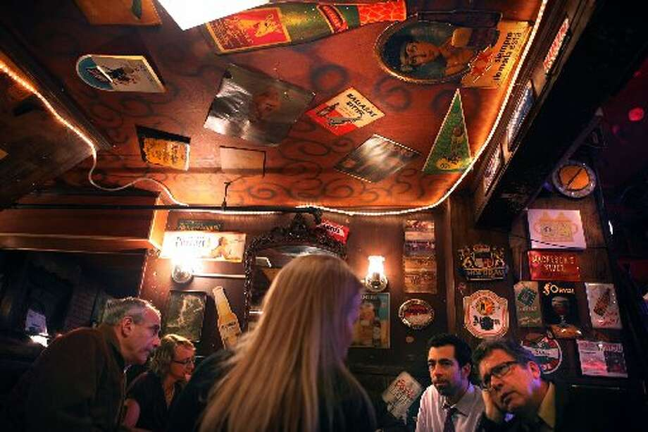 Even the ceiling is filled with items, some that date back to 1947. Photo: Liz Hafalia/The Chronicle 2011