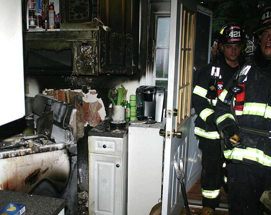 Fire damaged this kitchen Tuesday in the Sunnyridge Apartments after flames erupted in the oven. Photo: Fairfield Fire Department / Fairfield Citizen