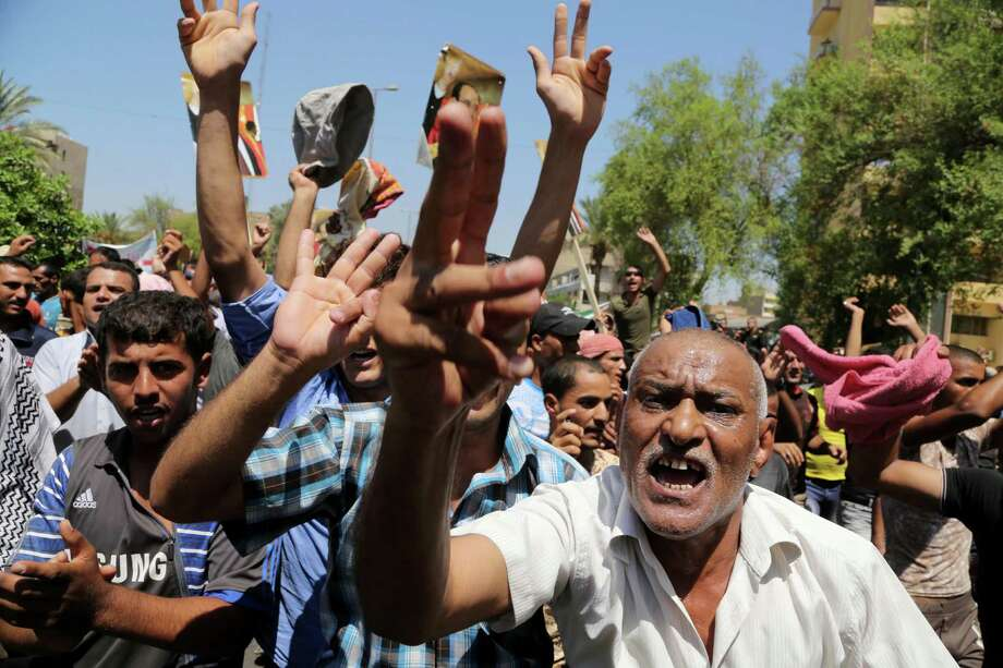 Supporters of Iraqi Prime Minister Nouri al-Maliki  protest  in Baghdad. Maliki must let go of power to make U.S. support worthwhile. Photo: Karim Kadim, Associated Press / AP