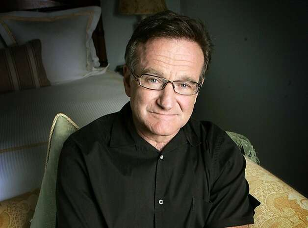 FILE - This June 15, 2007 file photo shows actor and comedian Robin Williams posing for a photo in Santa Monica, Calif. Williams, whose free-form comedy and adept impressions dazzled audiences for decades, died Monday, Aug. 11, 2014, in an apparent suicide. Williams was 63.  (AP Photo/Reed Saxon, File) Photo: Reed Saxon, Associated Press