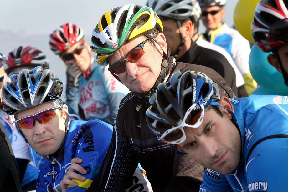 Listening to a few speeches just before the start of the race, from left, Dylan Casey, retired olympian, actor Robin  Williams, and George Hincapie, professional bike racer.