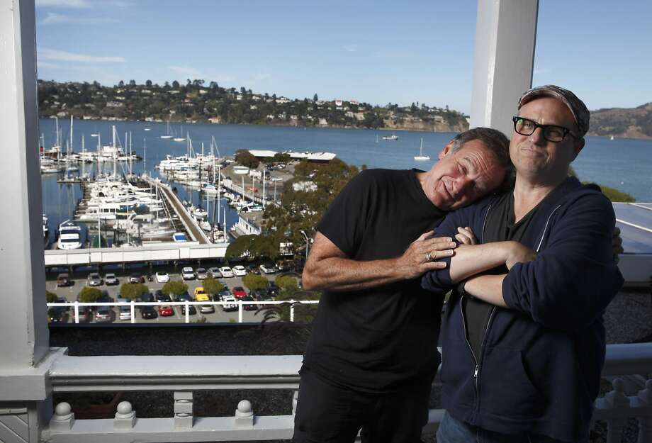 "Bobcat Goldthwaite, right, poses with Robin Williams while publicizing ""World's Greatest Dad."" Photo: Carlos Avila Gonzalez, The Chronicle"