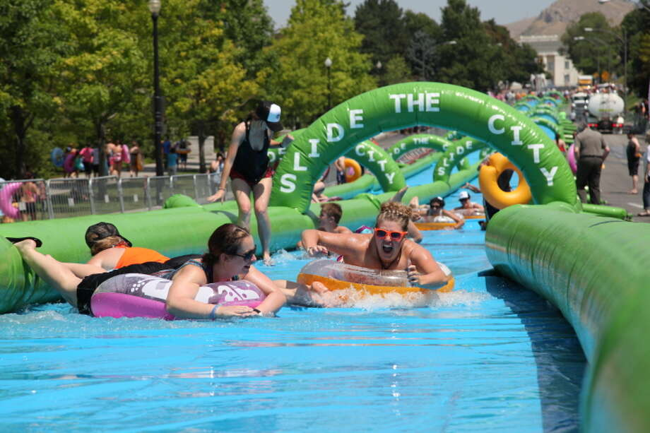 "Slide down a two lane, 1,000-foot slip-and-slide during ""Slide the City,"" described as a ""family friendly slip-and-slide water party"" with ""live music, food, drinks, water, and of course the biggest slip and slide ever to hit asphalt."" The event comes to Stamford and Danbury this summer. Find out more:StamfordDanbury Photo: Courtesy, Slide The City"