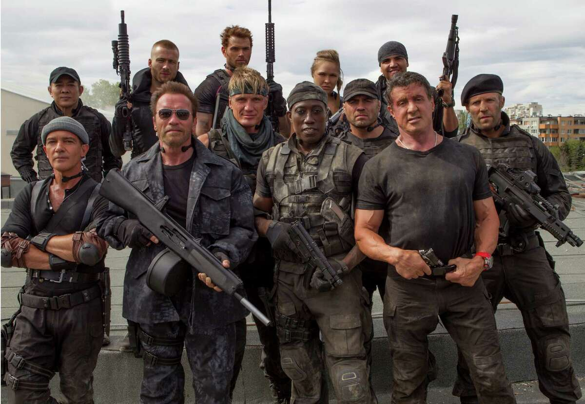 The Expendables are, from left, back row: Jet Li, Glen Powell, Kellan Lutz, Ronda Rousey and Victor Ortiz; and, front row: Antonio Banderas, Arnold Schwarzenegger, Dolph Lundgren, Wesley Snipes, Randy Couture, Sylvester Stallone and Jason Statham.