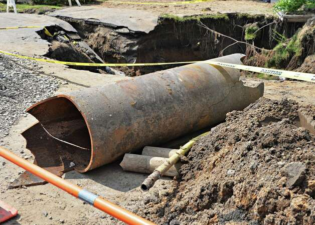 A section of damaged water main pipe on Princetown Road, one of four water main breaks that left more than two-thirds of town residents without water Tuesday July 1, 2014, in Rotterdam, NY.   (John Carl D'Annibale / Times Union) Photo: John Carl D'Annibale / 00027589A