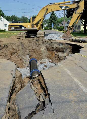 A new section of water main pipe, center, in place on Princetown Road, one of four water main breaks that left more than two-thirds of town residents without water Tuesday July 1, 2014, in Rotterdam, NY.   (John Carl D'Annibale / Times Union) Photo: John Carl D'Annibale / 00027589A