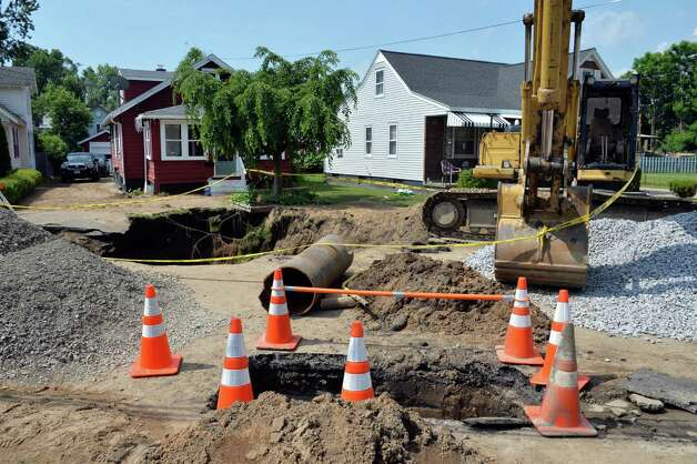 A section of damaged water main pipe, center, on Princetown Road, one of four water main breaks that left more than two-thirds of town residents without water Tuesday July 1, 2014, in Rotterdam, NY.   (John Carl D'Annibale / Times Union) Photo: John Carl D'Annibale / 00027589A