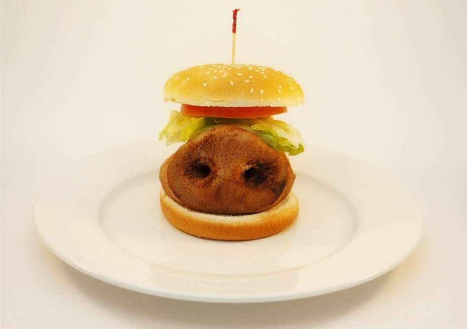 "Fast food nightmares continue with the ""Mystery Meat"" photo series by Texas native Peter Augustus, designed to open the eyes of fast food consumers. In this photo, he replaced the hamburger patty with a pig's snout. Photo: Peter Augustus"