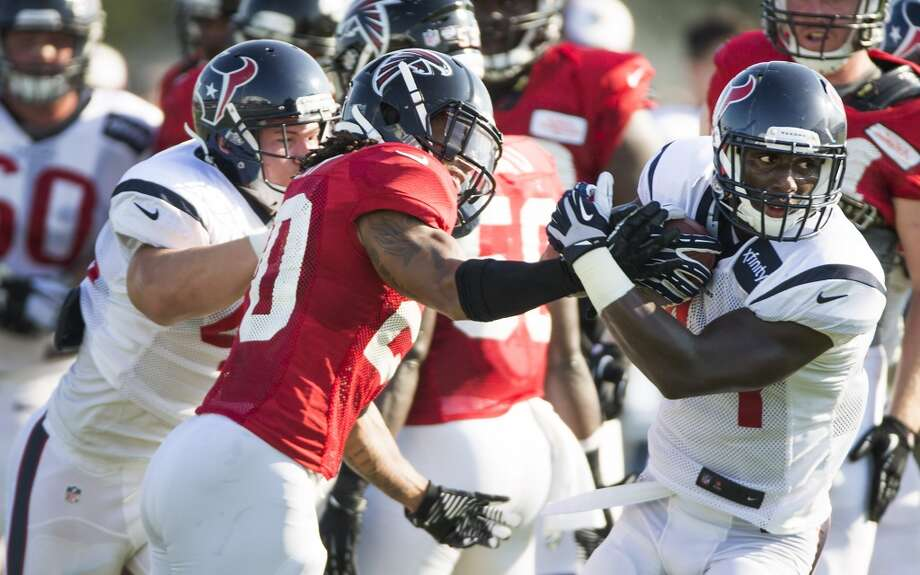 Day 14: August 13   Texans running back Alfred Blue (44) runs the ball past Atlanta Falcons free safety Dwight Lowery (20). Photo: Brett Coomer, Houston Chronicle