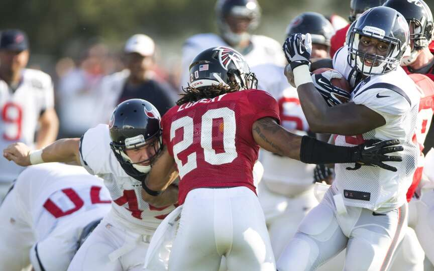 Texans running back Alfred Blue (44) runs the ball past Atlanta Falcons free safety Dwight Lowery (2