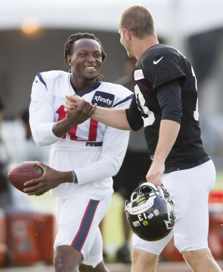Texans wide receiver DeAndre Hopkins (10) greets former teammate Atlanta Falcons quarterback T.J. Yates (13). Photo: Brett Coomer, Houston Chronicle