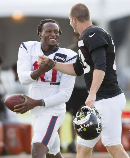 Texans wide receiver DeAndre Hopkins (10) greets former teammate Atlanta Falcons quarterback T.J. Ya