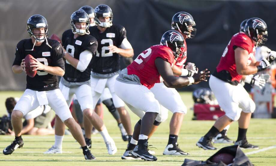 Atlanta Falcons quarterbacks T.J. Yates (13), Jeff Matthews (9) and Sean Renfree (12) drop back to pass. Photo: Brett Coomer, Houston Chronicle