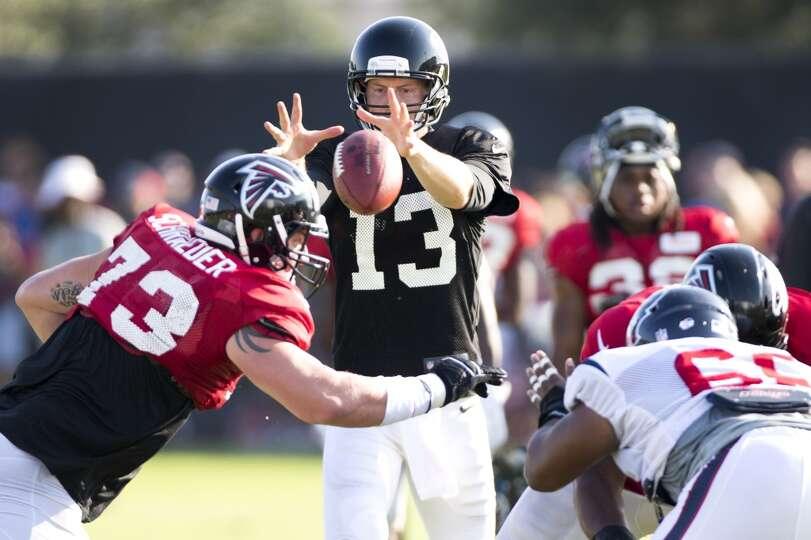 Atlanta Falcons quarterback T.J. Yates (13) takes a snap as he lines up against the Texans during a