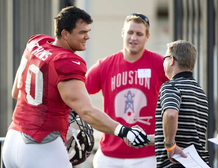 Atlanta Falcons offensive tackle Jake Matthews (70) greets a friend as he walks onto the practice fi