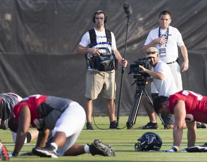 A film crew from HBO's Hard Knocks shoot the Atlanta Falcons during their joint practice with the Te
