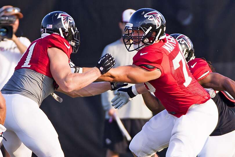 Atlanta Falcons offensive tackle Jake Matthews (70) blocks defensive end Kroy Biermann (71).